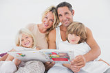 Happy family reading a fairy tale together