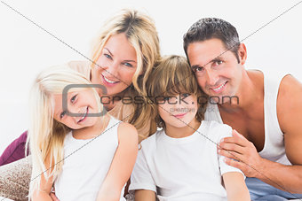 Cute family smiling for portrait