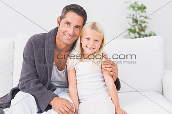 Father and child looking at camera