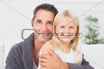 Father hugging his daughter