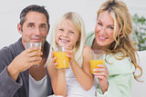 Family drinking glasses of orange juice