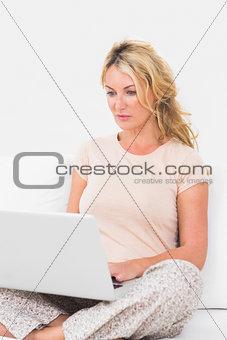 Calm woman using a laptop