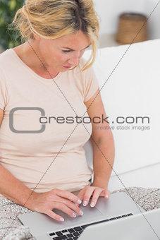 Blonde woman using her laptop