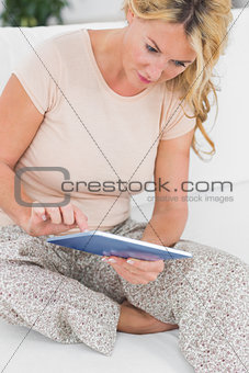 Calm woman touching her tablet pc