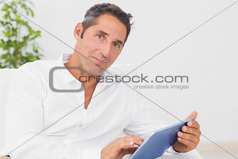 Calm man with his digital tablet