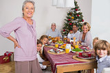 Grandmother standing beside dinner table