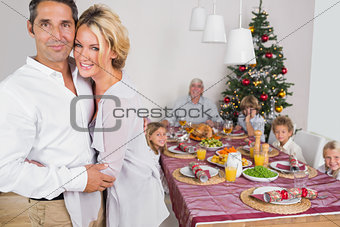 Husband and wife standing by the dinner table