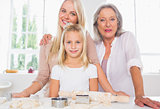 Mothers and daughters cooking together