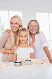Smiling mothers and daughters cooking together