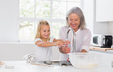 Grandmother and granddaughter washing hands