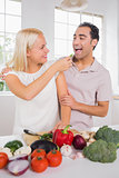 Wife giving vegetable to her husband