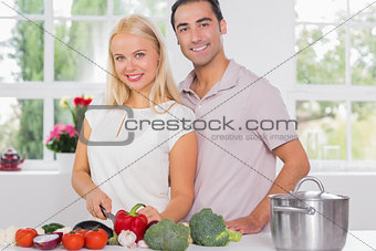Blonde woman cooking with her husband