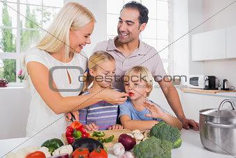 Family tasting vegetables