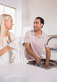 Talking couple washing dishes together