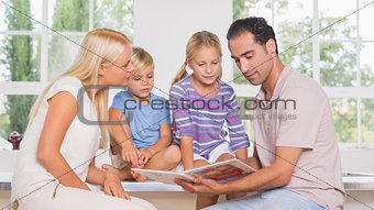 Calm family reading a story together