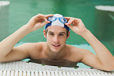 Man taking off his swimming goggles