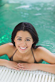Woman looking up from swimming pool