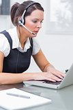 Business woman wearing headset in office