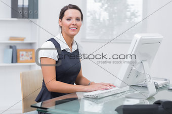 Portrait of confident female executive using computer
