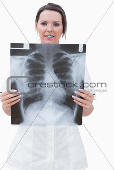 Portrait of young nurse with xray