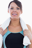 Portrait of young woman in sportswear holding towel around neck