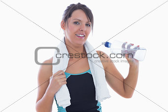 Portrait of woman in sportswear drinking water