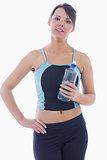 Portrait of woman in sportswear holding water bottle