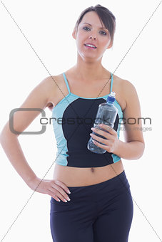 Portrait of woman in sportswear holding water bottle