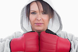Closeup of young woman wearing boxing gloves