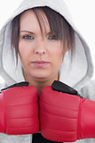 Closeup portrait of young woman wearing boxing gloves