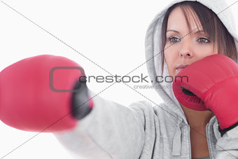Serious young woman in boxing stance