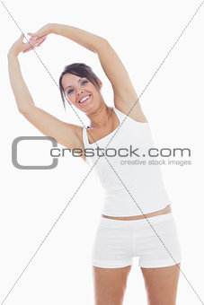 Portrait of smiling woman in sportswear holding hands up together