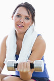 Portrait of woman exercising with dumbbell