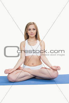 Portrait of young woman sitting in lotus position