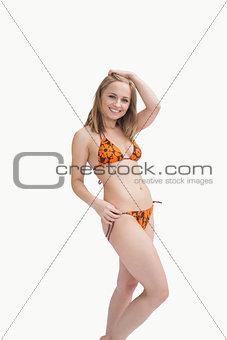 Portrait of happy young woman posing in bikini