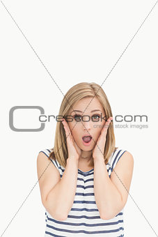 Portrait of surprised casual young woman