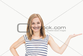 Portrait of casual woman holding out open palm