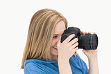 Side view of happy female photographer with photographic camera