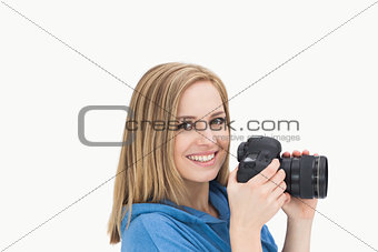 Portrait of happy female photographer with photographic camera