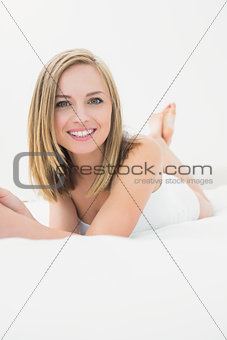 Portrait of beautiful happy woman in bed