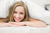 Closeup portrait of beautiful woman in bed