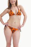 Happy young woman posing in bikini