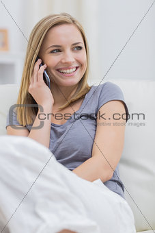 Casual happy woman using cellphone at home