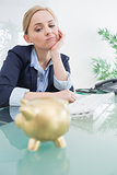 Upset business woman with piggy bank office