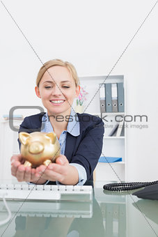 Smiling business woman with piggy bank office