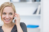 Closeup of business woman using mobile phone in office