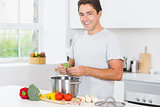 Smiling man making dinner