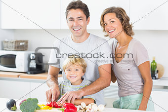 Happy family preparing vegetables