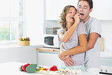 Husband and wife having fun in kitchen