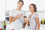 Smiling couple enjoying red wine together